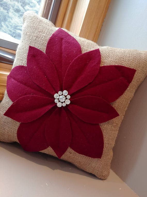 small decorative burlap pillow with flower from vintage wool and pin