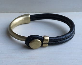 BLACK leather with ANTIQUE BRASS half cuff button clasp.