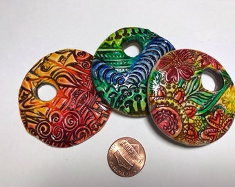 3 Brand new pendant pieces by Marie Segal using one of her Ceramic techniques