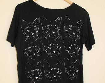 Black t shirt with a White cat print