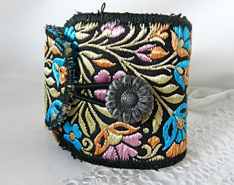 Adjustable cuff bracelet in embroidered floral fabric