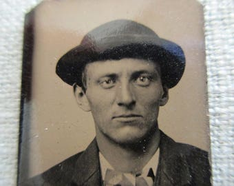 antique small tintype photo - 1800s, man with hat, glass eye?