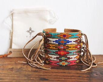BC-11, handmade Native American inspired adjustable beaded  cuff bracelet with fringe