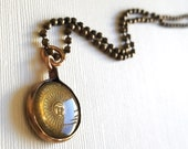 Tiny Argentine Sun Coin Pendant