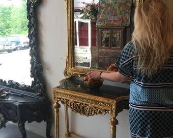 Gilt marble console and mirror. Interior Design