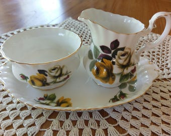 Royal Albert unnamed pattern eight hundred and five Yellow and white rose with burgundy and green leaves with a few buds in the same colours