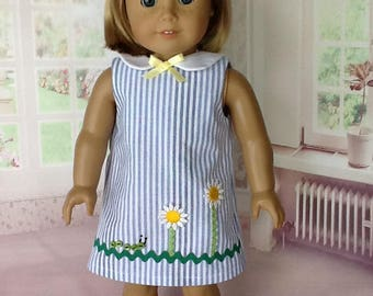18 inch doll dress and hair clip. Blue seersucker with flower trim.