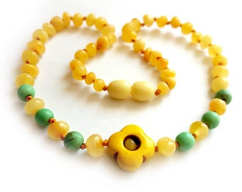 NEW Unique Baby Teething Baltic Amber Necklace with Flower Pendant