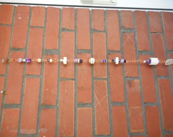 Yard or garden art for the patio or fence or to hang from a tree. This is made from upcycled materials to keep it from the landfill.