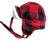 Buffalo plaid trapper hat for toddler with cream colored sherpa lining. Fits up to 18