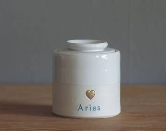 custom small urn. quote with gold infilled stamp, and lid, straight shaped urn with custom name. modern urn for ashes. white with blue