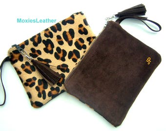 Monogramed Hair on hide clutch purse suede back and tassel