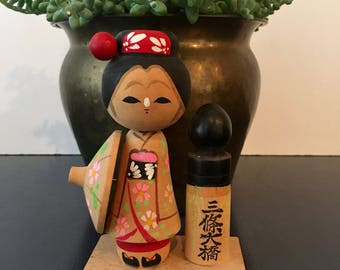 vintage Kokeshi doll with parasol
