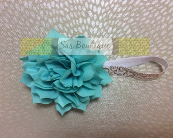 Turquoise ruffled flower bow with white/gold elastic band