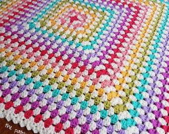 Hand made crochet baby blanket in rainbow shades approximately 60cm square