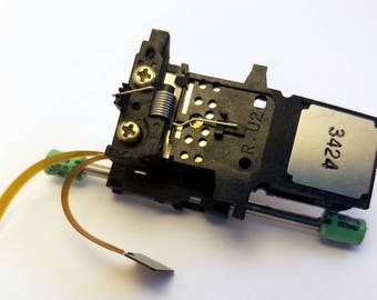 CD Rom part pin with small capacitor accents