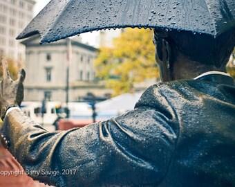 "Umbrella Man or ""Allow Me"" statue, Pioneer Courthouse Square in Portland Oregon"