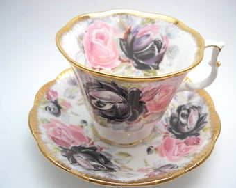 Royal Albert  Summer Bounty Series Sapphire Tea Cup And Saucer, Heavy Gold edge,  Pink and Black Roses.