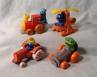 4 Metal Car & Vehicle Toys - 1980s Sesame Street, Smurf -  Grover in Helicopter, Cookie Monster in Train, Oscar in Car, Smurf in Tractor