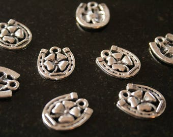 18 charms in antique silver Horseshoe. (ref:2436).