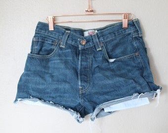 vintage 1980's distressed cut off levis 501 button fly  jean shorts 30 32