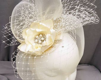 Vintage bridal hat with ivory mesh and satin flower. ADORA by parchment and pearls
