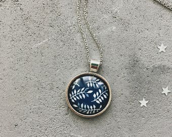 Leaves pattern necklace on navy background, dark blue and white pendant by CuteBirdie