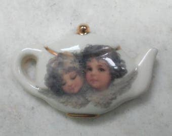 Magnet Angelic decal  tea pot  shape in porcelain with gold china paint