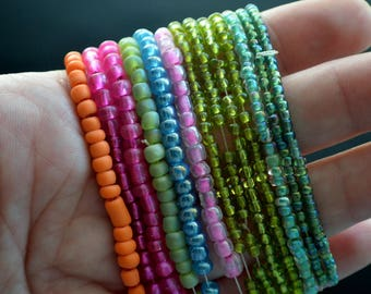 Lot of Seed Beads Different Sizes and Assorted Colors