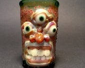 Large Green Monster triclops shot glass with teeth and glow in the dark eyes 2.75 x 1.75 x 1.75