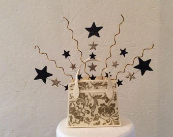 Handbag cake topper with stars and twists