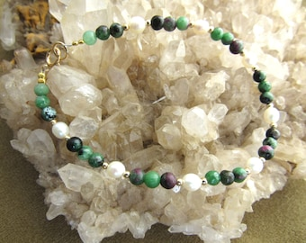 Bracelets done with gemstone ruby  zoisite and fresh water pearl, 12k gold filled or sterling silver beads and clasp  Have 7 , 7 1/2 , 8 .