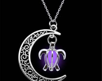 X 1 moon pendant necklace and bright purple turtle