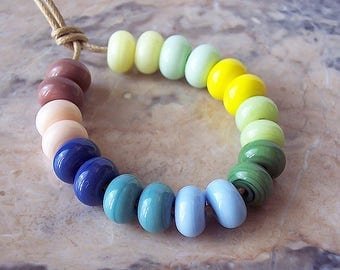 Pastel. Handmade Lampwork Spacer Beads  (20 pcs) 7,5-8,5 mm x 4-5 mm. The Color Scheme of Light Blue, Light Green, Yellows and Pink Hues.