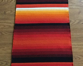 """Long very well done Hand-woven wall hanging weaved in wool with """"Tuskaft"""" in beautiful strong colors  from Sweden 1970s."""