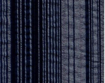 Fabric slightly wrinkled striped gray and black