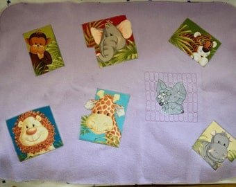 Cute purple fleece blanket with baby animals for all sizes of baby dolls