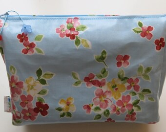 Flowers on blue waxed canvas toiletry bag