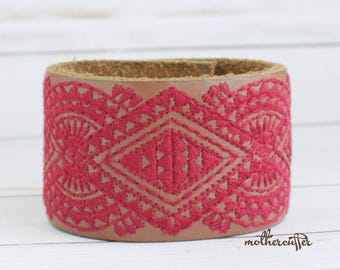 CUSTOM HANDSTAMPED wid brown leather cuff with red stitching by mothercuffer