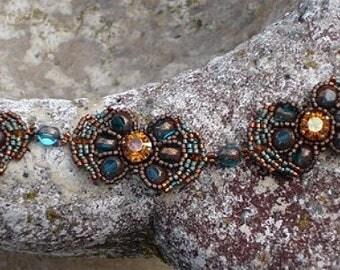 Bracelet fleurs de verre bleu turquoise foncé et ocre