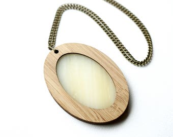 Ivory coloured Glass in Wooden Oval Pendant on chain