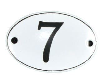"Plate ""No. 7"" in white and black enamel"