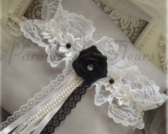 White garter set with a black rose, accompany with lace, Ribbon and white beads