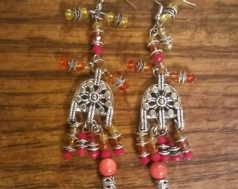 Silver and red/orange/yellow earrings by Jukeboxx Jewelry and crochet