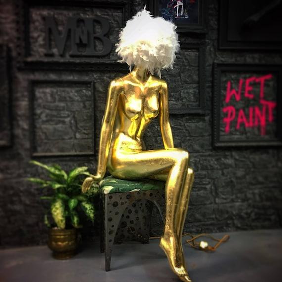 Female sitting mannequin lamp in gold leaf gilding