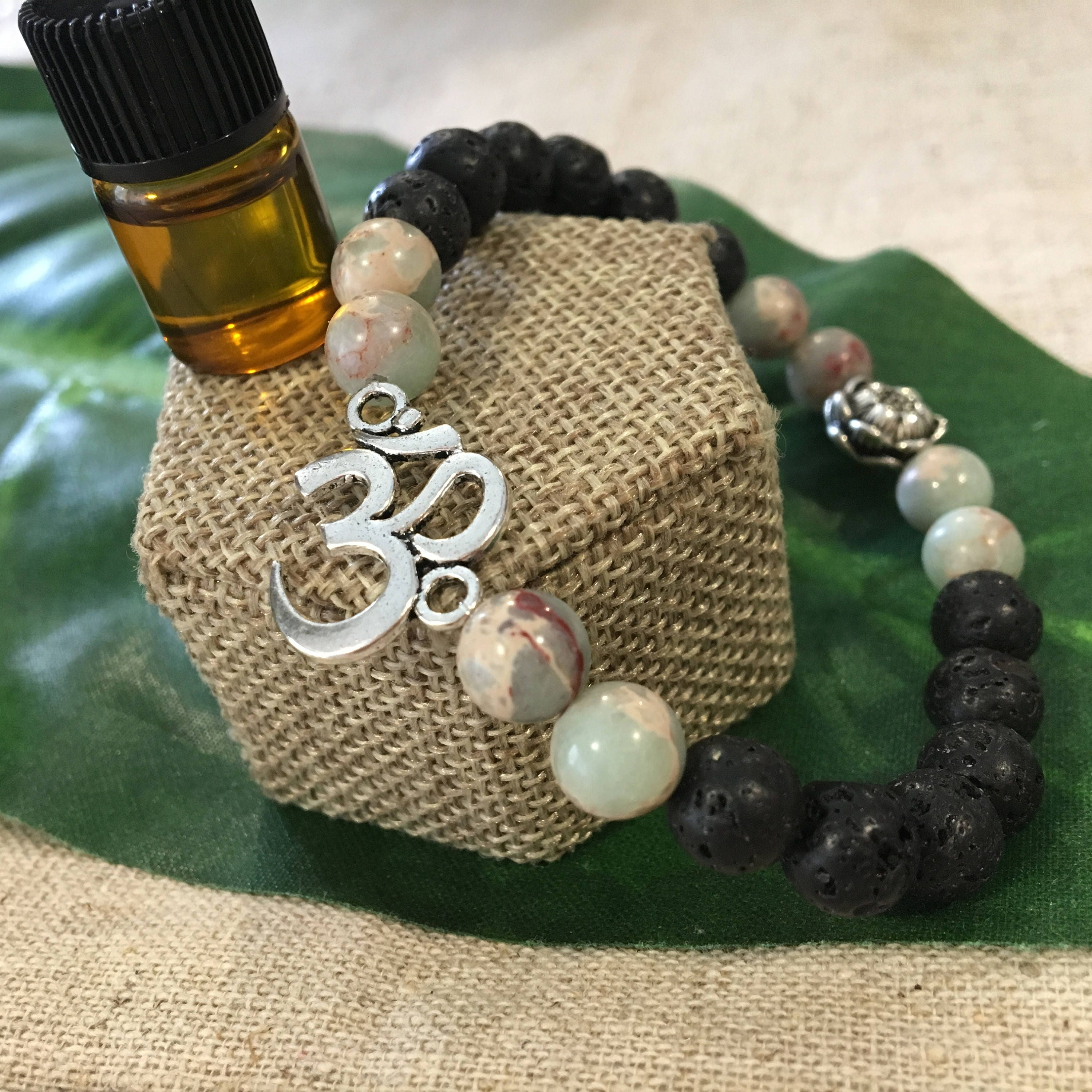 Volcanic Black Lava Rock Beaded Bracelet Accented With Om Connector