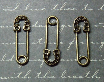 3 charms 8x23mm bronze metal safety pin