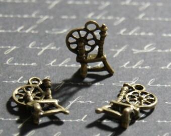 2 breloques rouet en métal couleur bronze 12x18mm