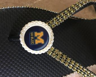Michigan blue flip flops
