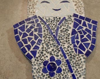 Japanese doll in blue and white mosaic